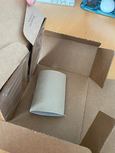 scent inside squashed tube inside box