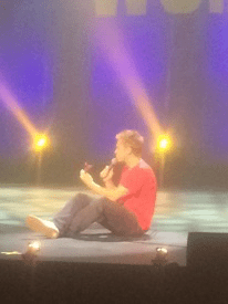 Russell Howard on stage with scentwork mouse
