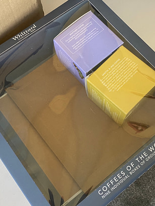 perspex box with small boxes inside
