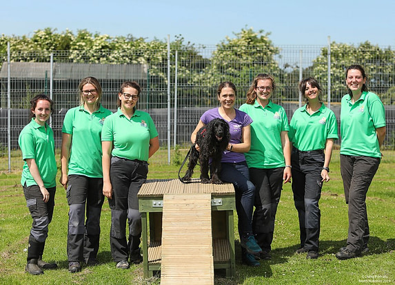 TDS trainer with smiling shelter staff